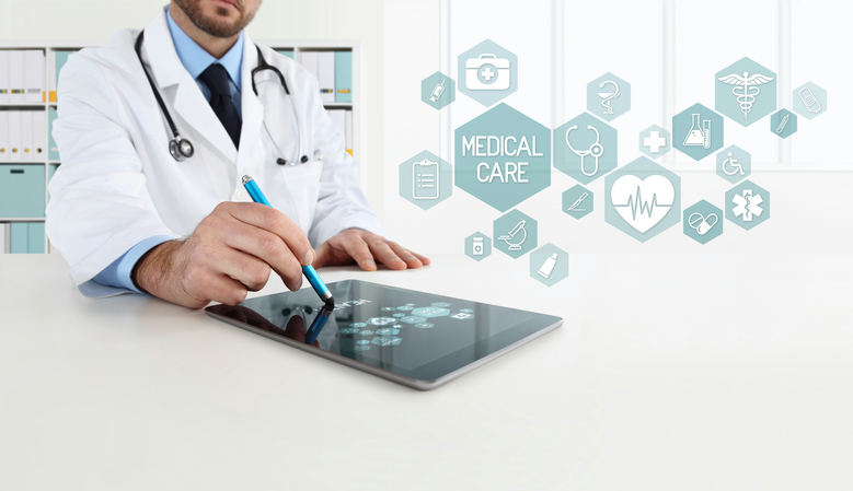 doctor uses the tablet with icons, in office desk