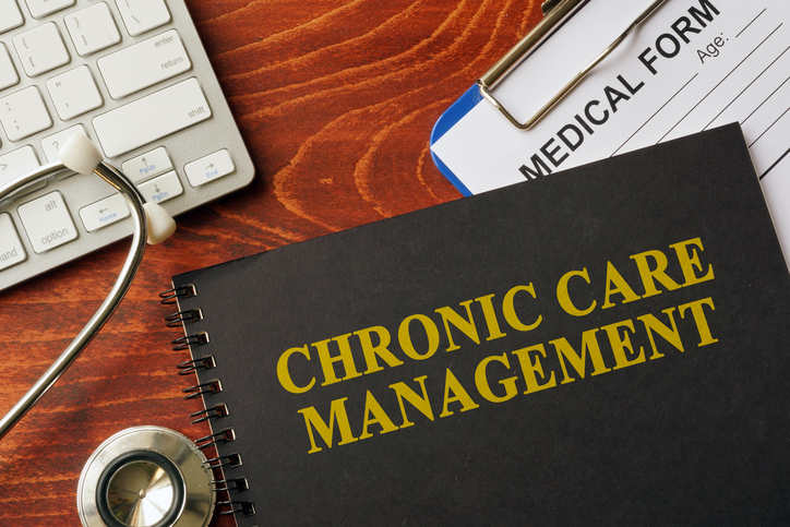 Book with title chronic care management on a table.